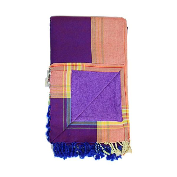 Soak up some sun with the Purple Kenyan Beach Towel! Our fair trade Kenyan Beach Towels are ethically crafted in Nairobi, Kenya. We back lightweight and absorbent hand-loomed cotton kikoy cloth with quick-dry microfiber terry for extra absorption. The hidden velcro pocket in the interior is perfect for storing your keys or phone!